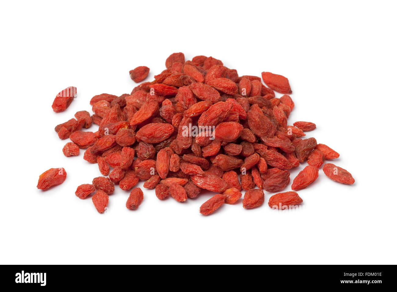 Heap of dried Goji berries on white background - Stock Image