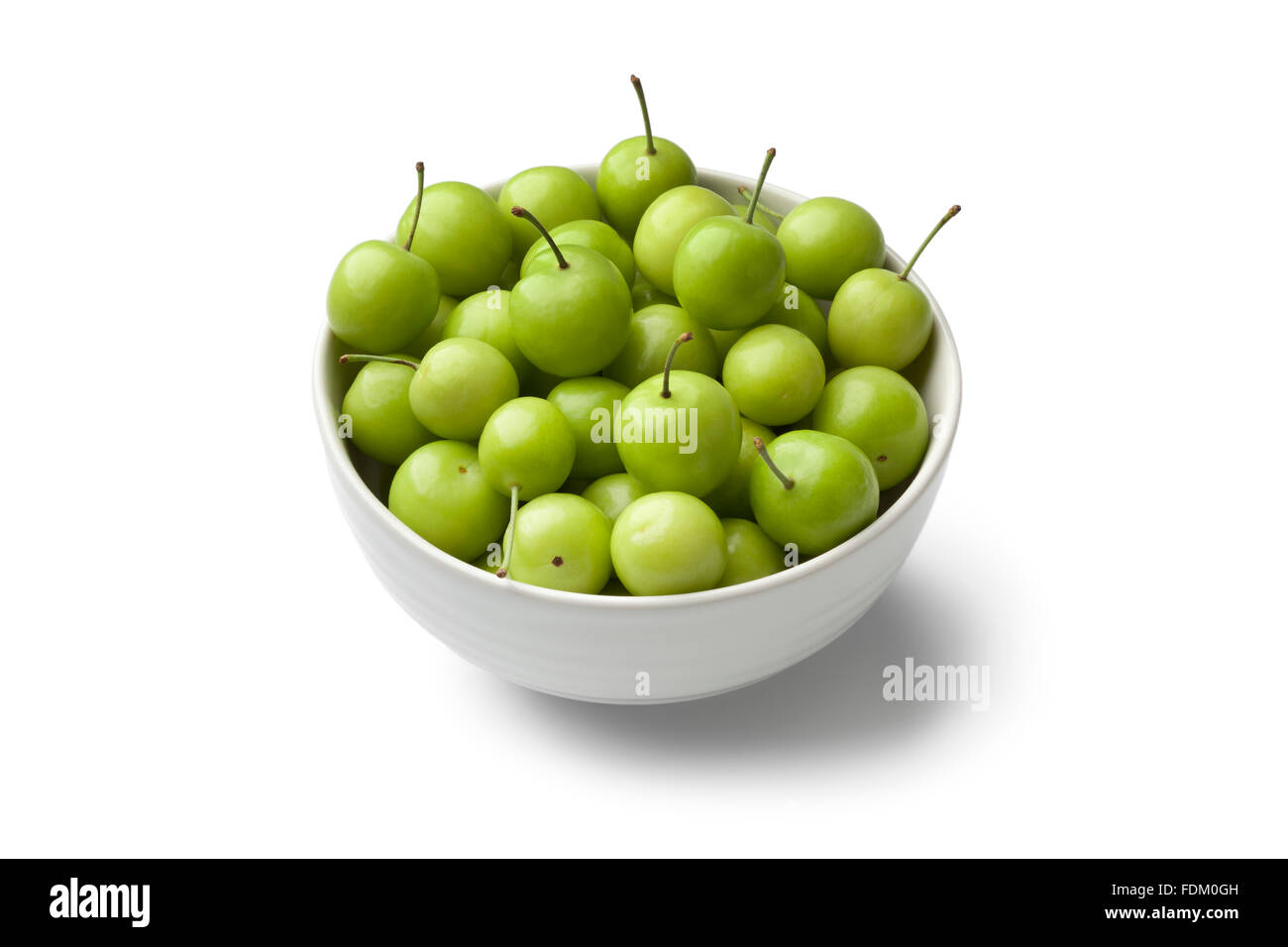 Fresh Can Erik plums in a bowl on white background - Stock Image