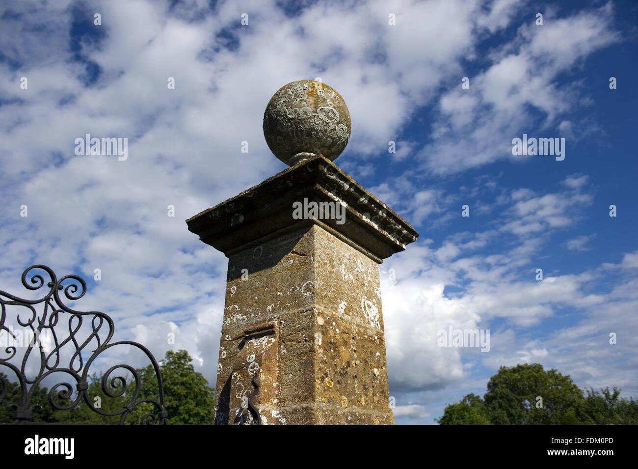 Stone ball atop a gatepost at Lytes Cary Manor, Somerset. - Stock Image