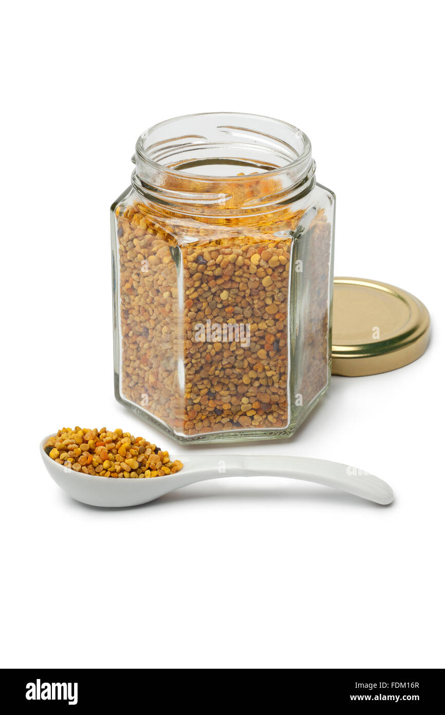 Bee pollen in a pot and on a spoon white background - Stock Image