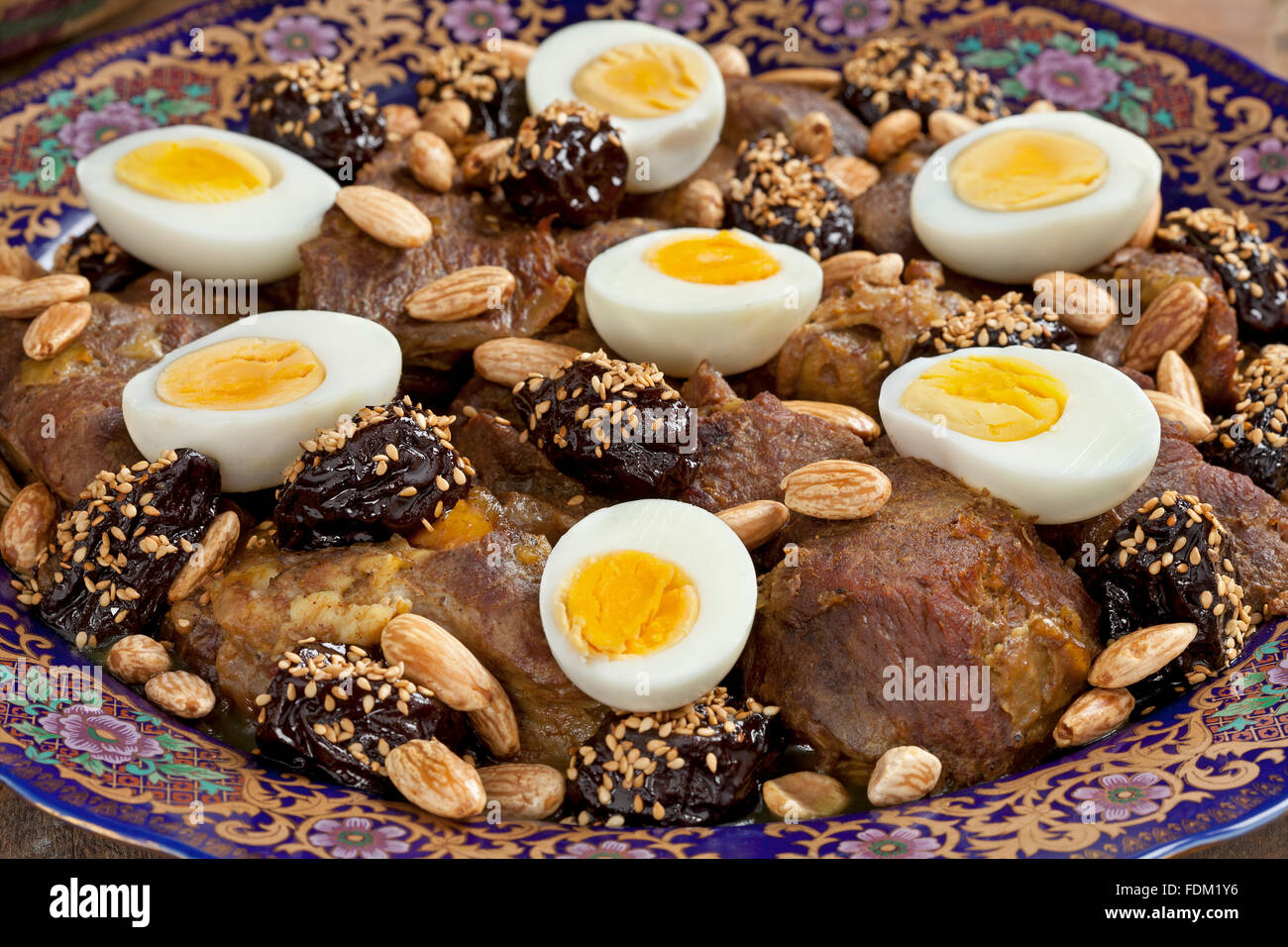Moroccan festivity dish with meat, plums,almonds and eggs close up - Stock Image