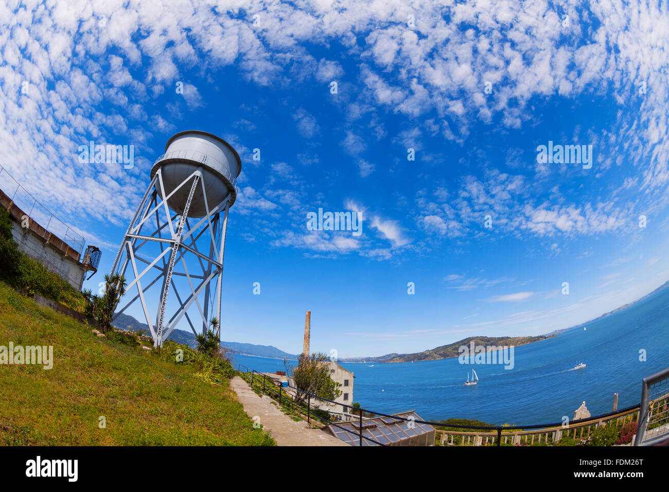 Water tower in Alcatraz island and SF bay - Stock Image