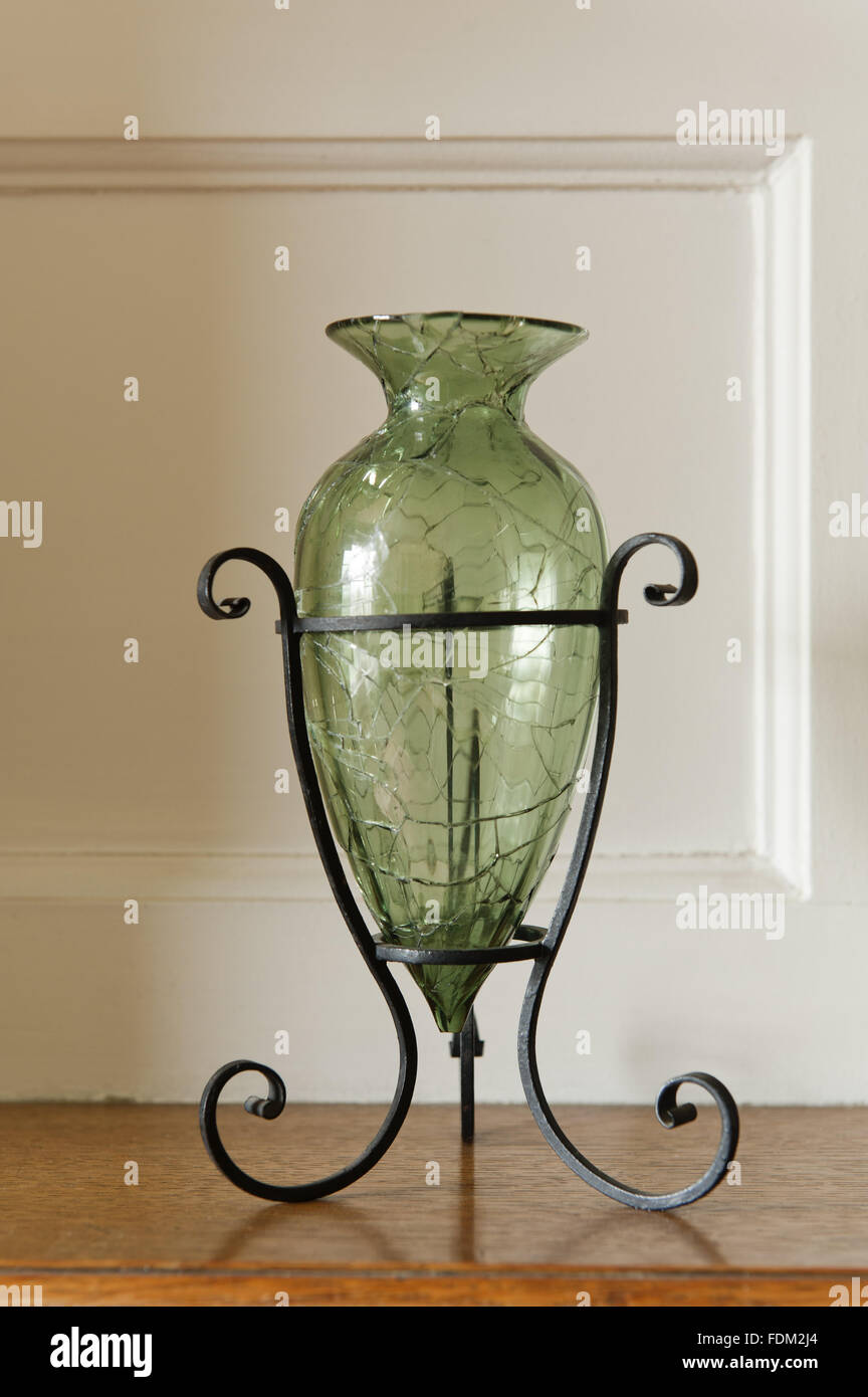 Green tinted glass vase, one of a pair, in the Larkspur Dressing Room at Standen, West Sussex. The vase was made - Stock Image