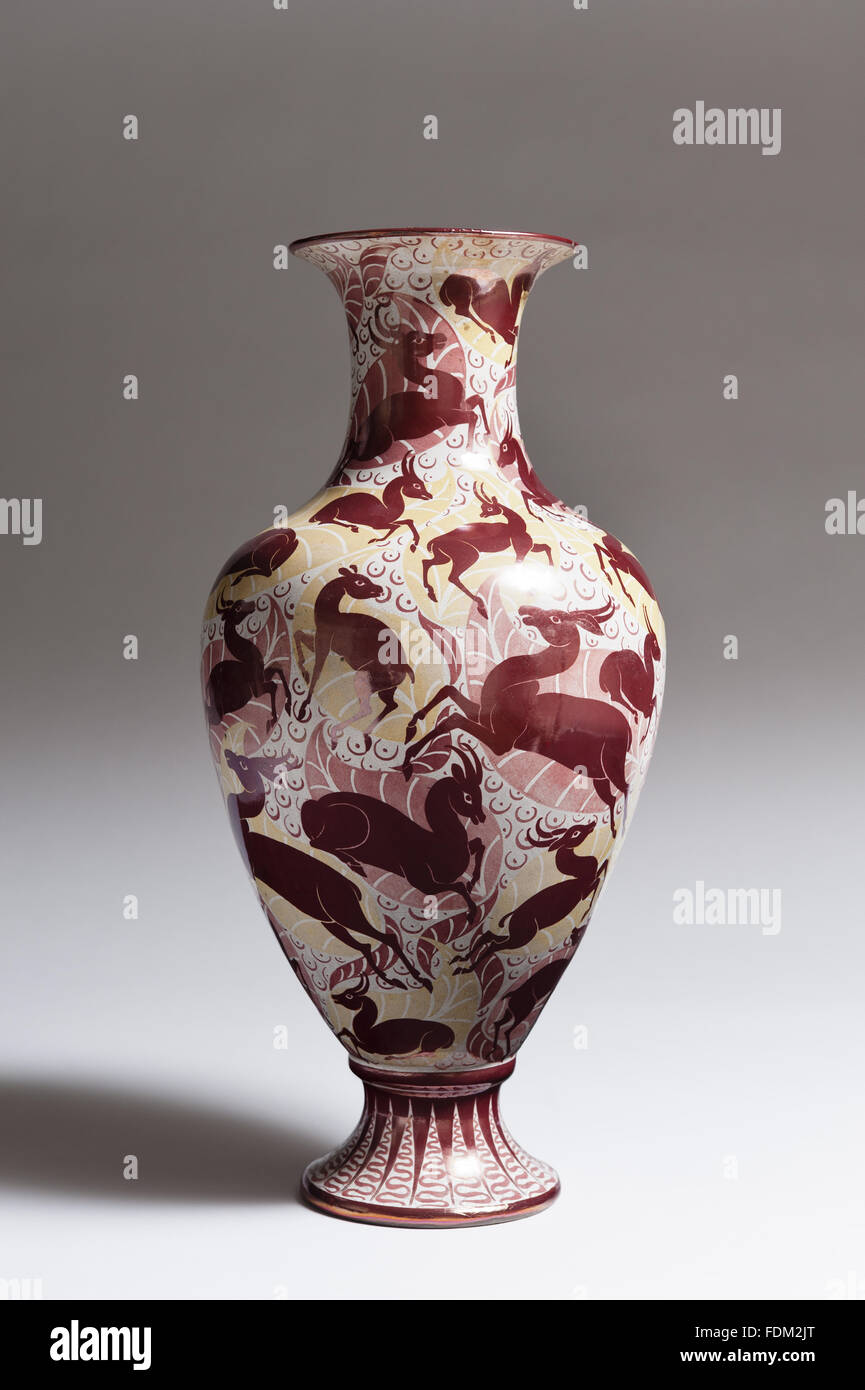 William de Morgan (1839-1917) copper lustre vase at Standen, West Sussex. The design is of antelopes on a stylised - Stock Image