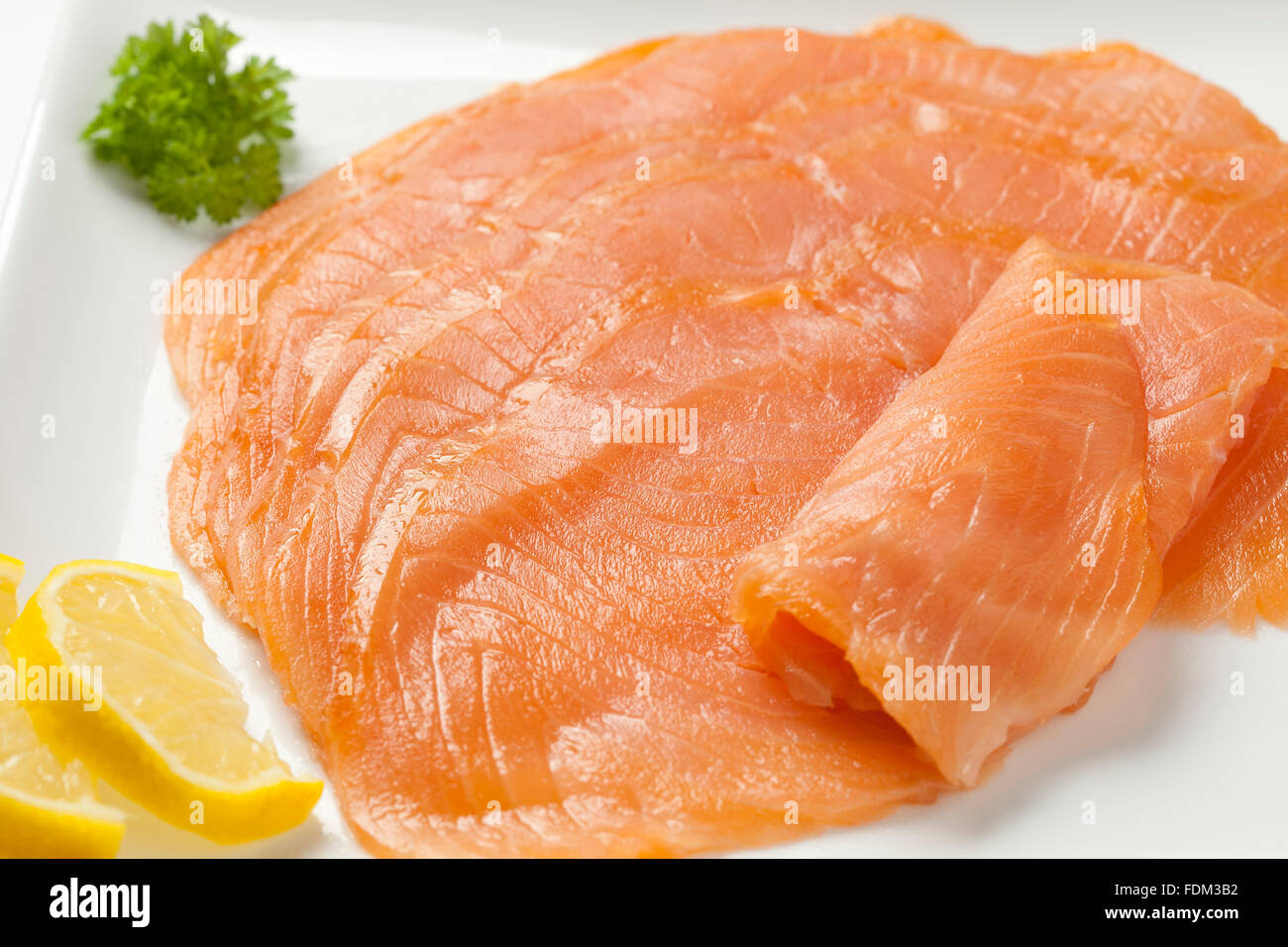 Smoked salmon slices on a plate - Stock Image
