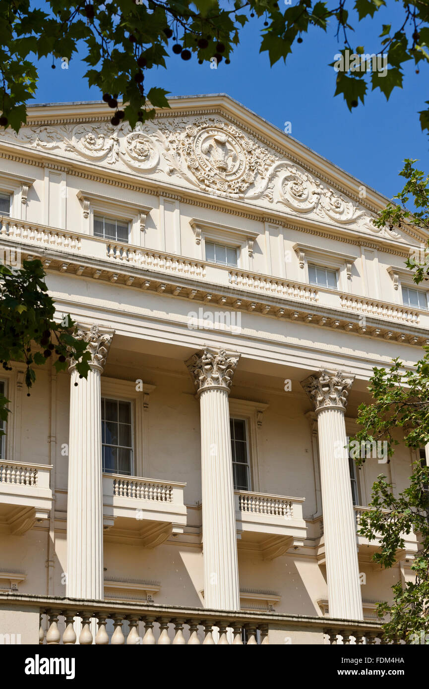 The Facade Of A White Building With Columns And Decorative