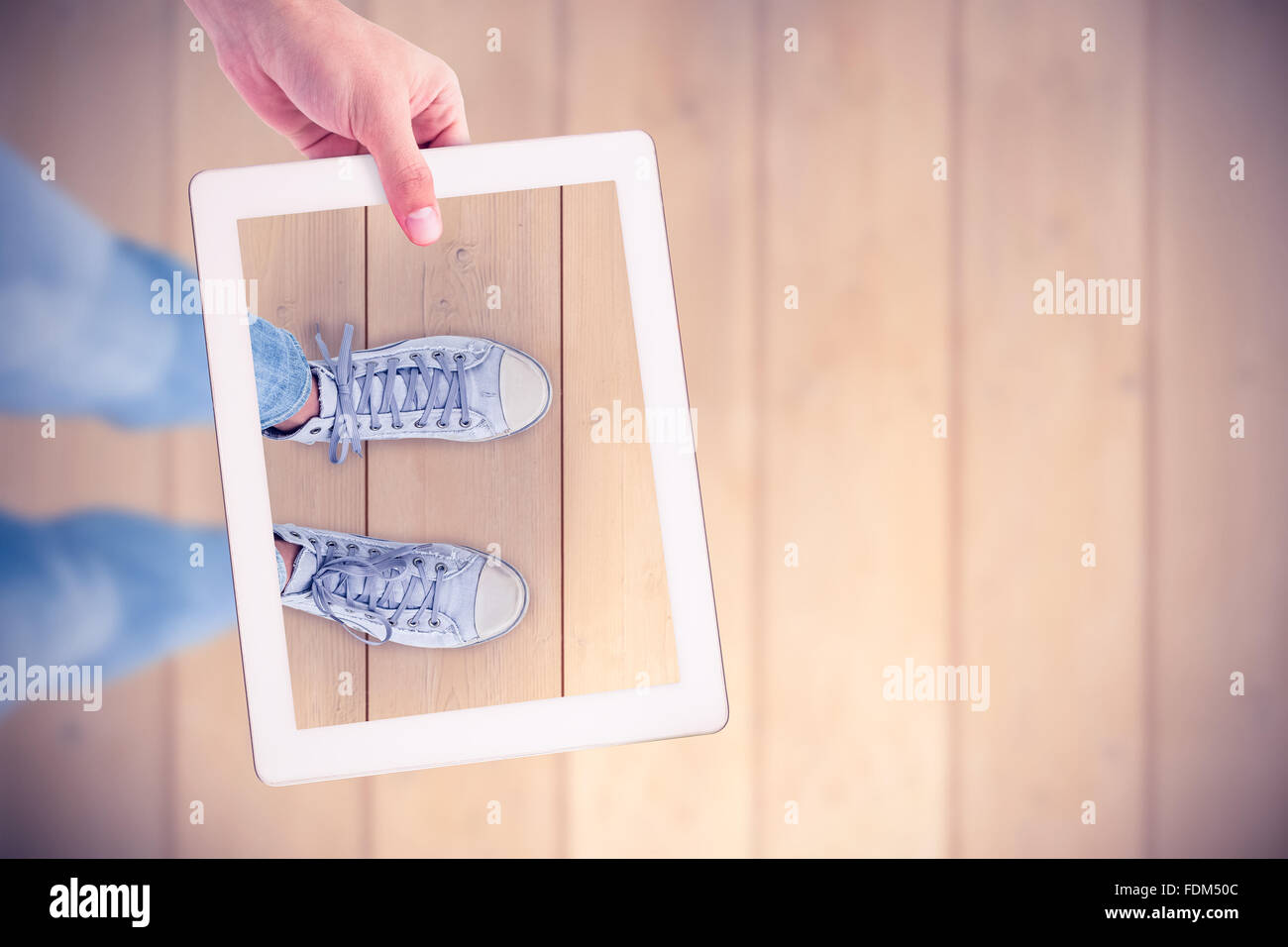Composite image of masculine hand holding tablet - Stock Image