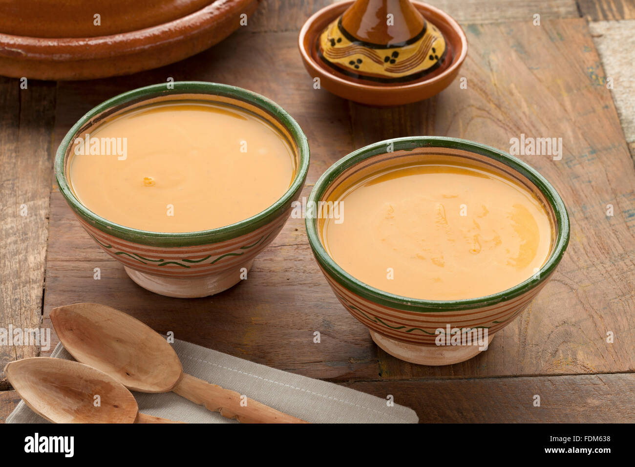 Traditional Moroccan Pumpkin Carrot soup ready to eat - Stock Image