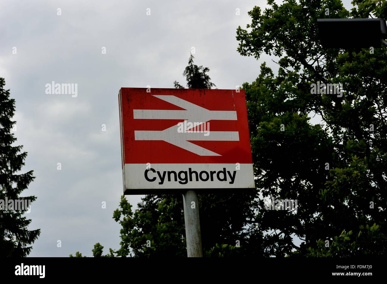 Cynghordy, double arrow National Rail Network station sign. Central / Heart of Wales Line. Wales, UK. - Stock Image