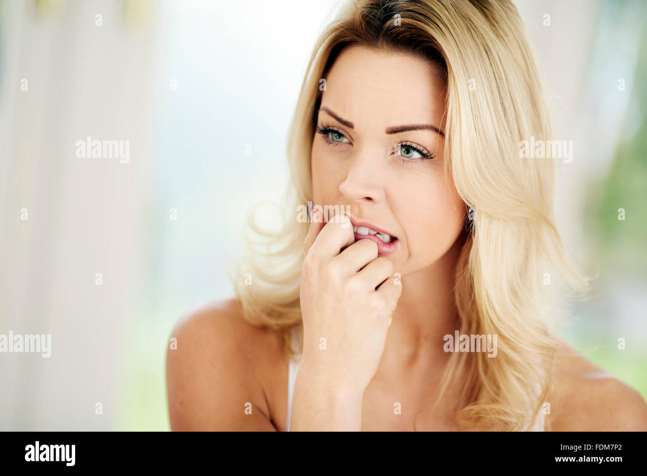 Woman looking anxious - Stock Image