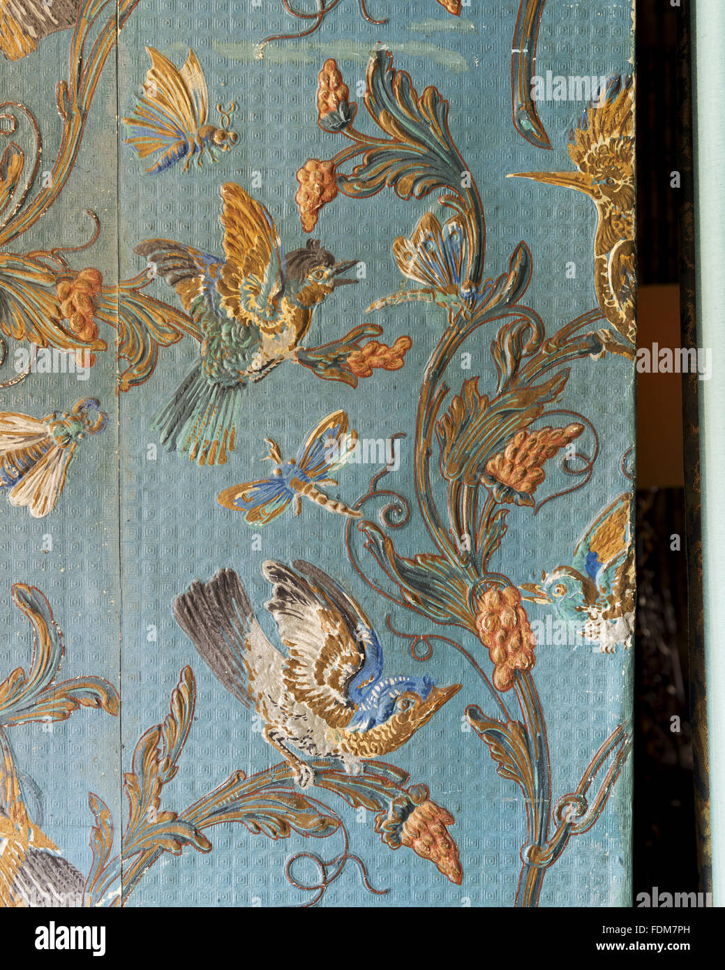 Detail of nineteenth-century Cordelova embossed wallpaper which simulates leather, with bird design in the Library - Stock Image