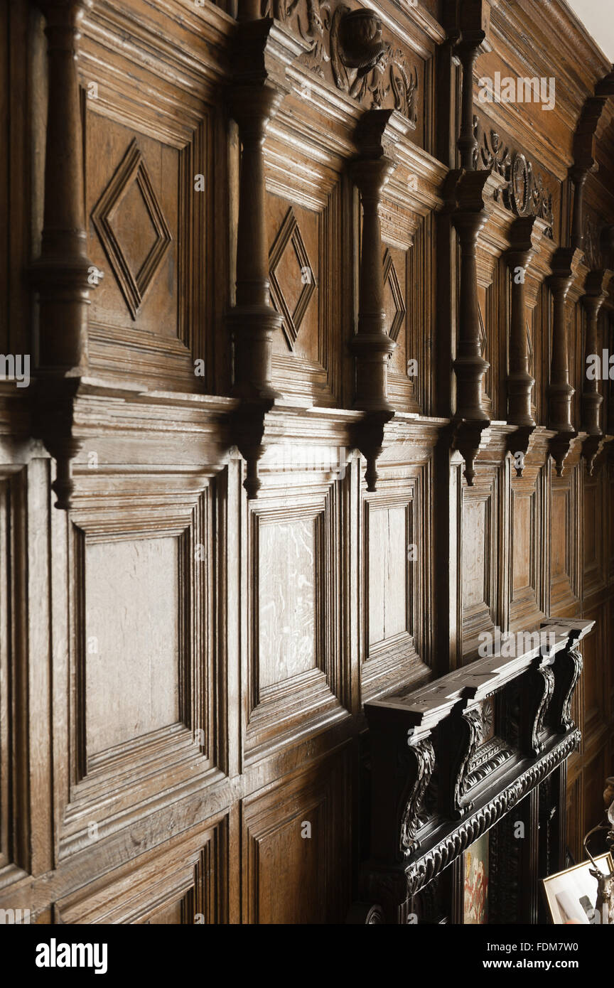 The sixteenth century wooden panelling in the Dining Room at Coughton Court, Warwickshire. - Stock Image
