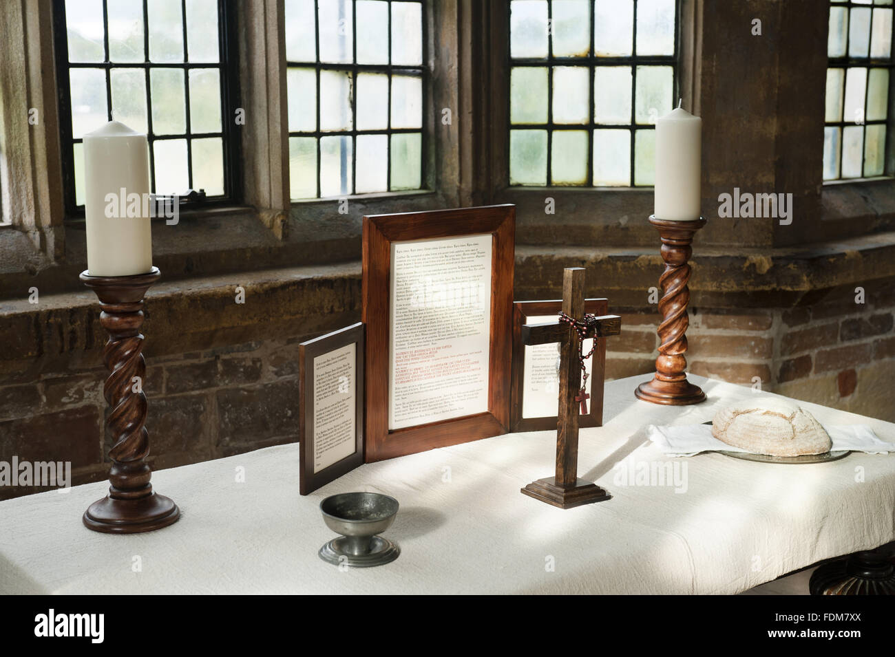Table in the window of the Tower Room laid out as a Roman Catholic altar at Coughton Court, Warwickshire. The Tower - Stock Image