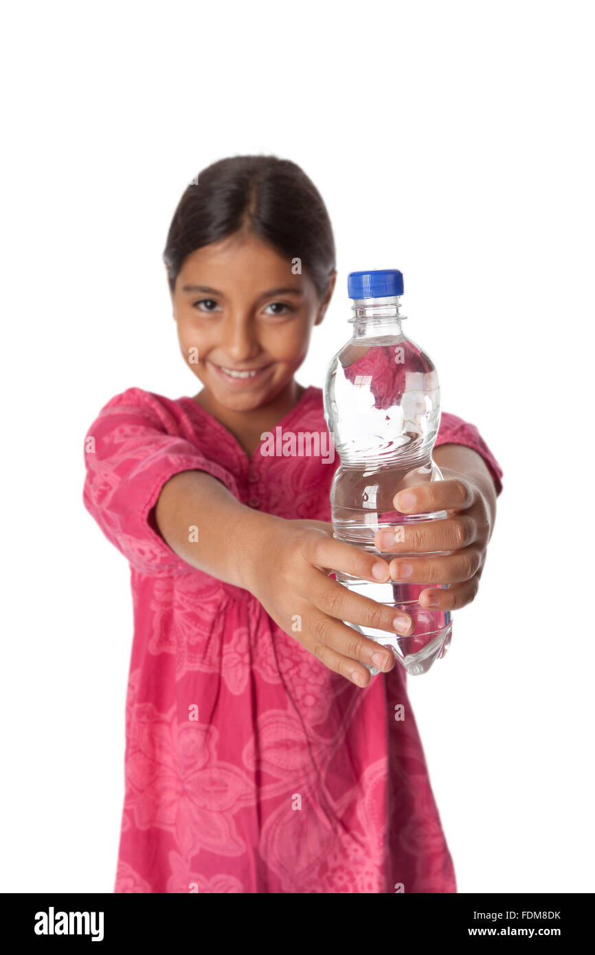 Young teenage girl showing a bottle with fresh water on white background - Stock Image