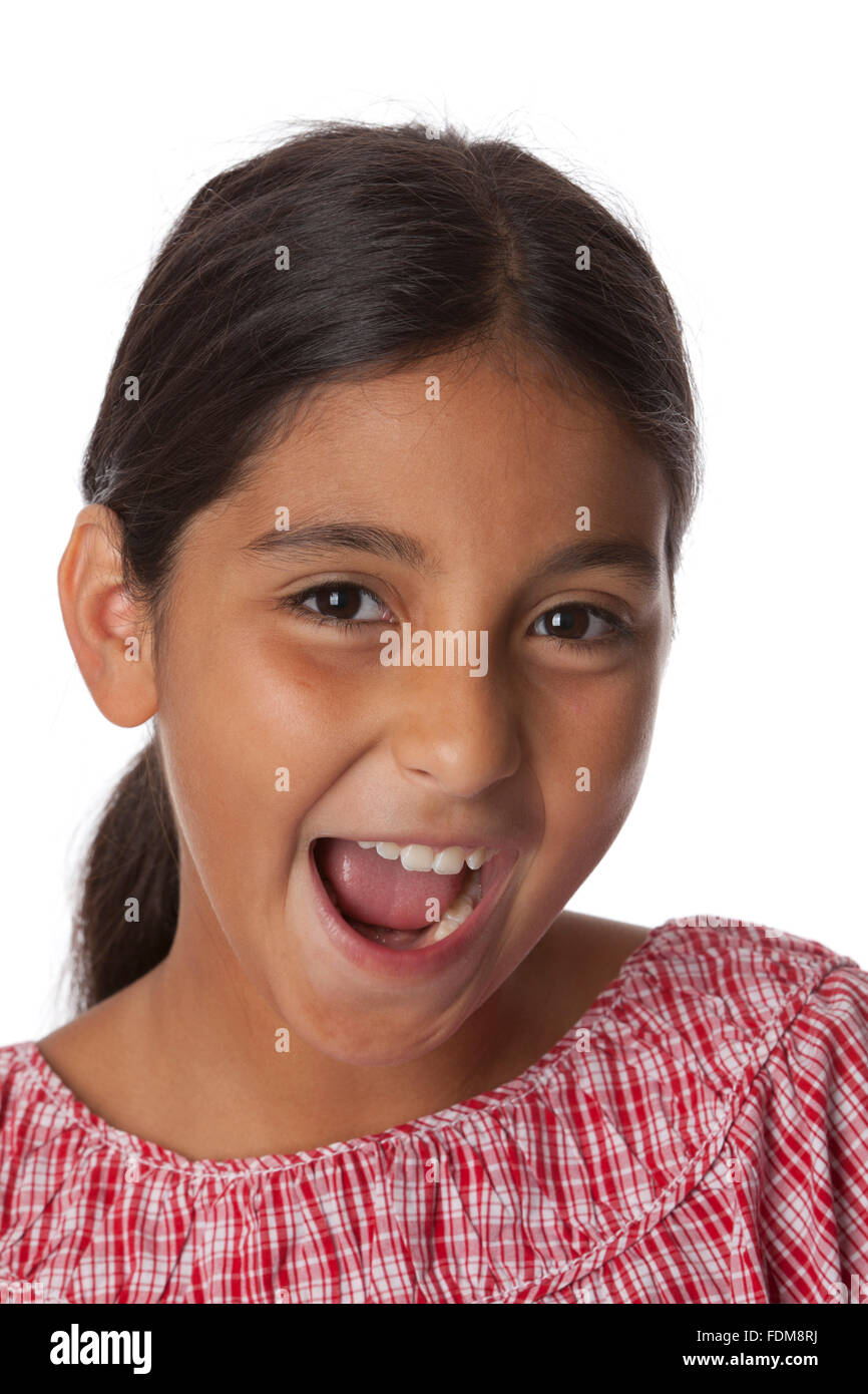 Young teenage girl making fun, portrait on white background - Stock Image
