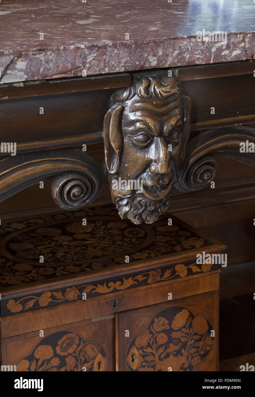 Carved satyr on an early eighteenth-century, George II style side table in the Tyrconnel Room at Belton House, Lincolnshire. - Stock Image