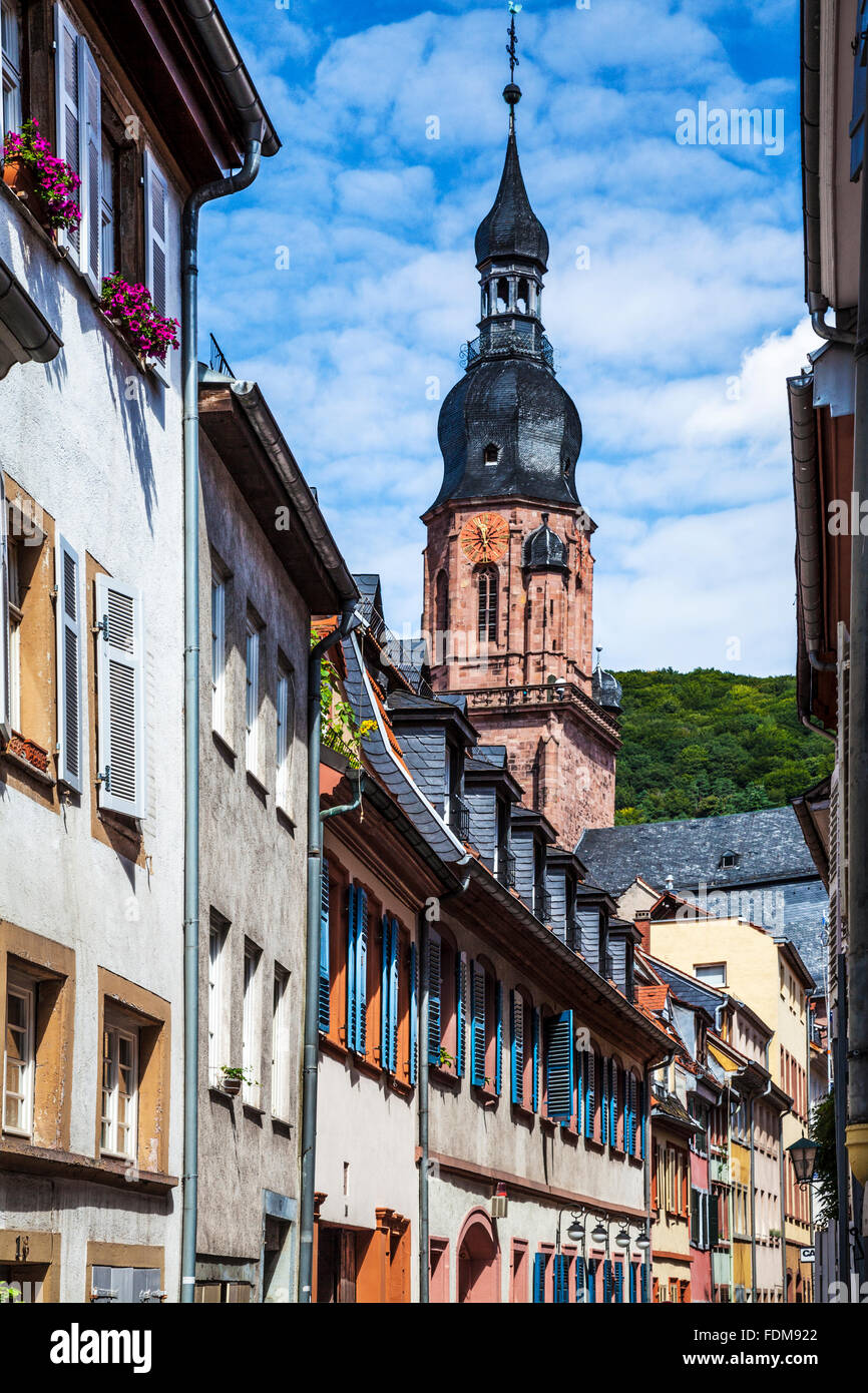 The spire of the Church of the Holy Spirit viewed from Kramergasse in the Altstadt quarter of Heidelberg. - Stock Image