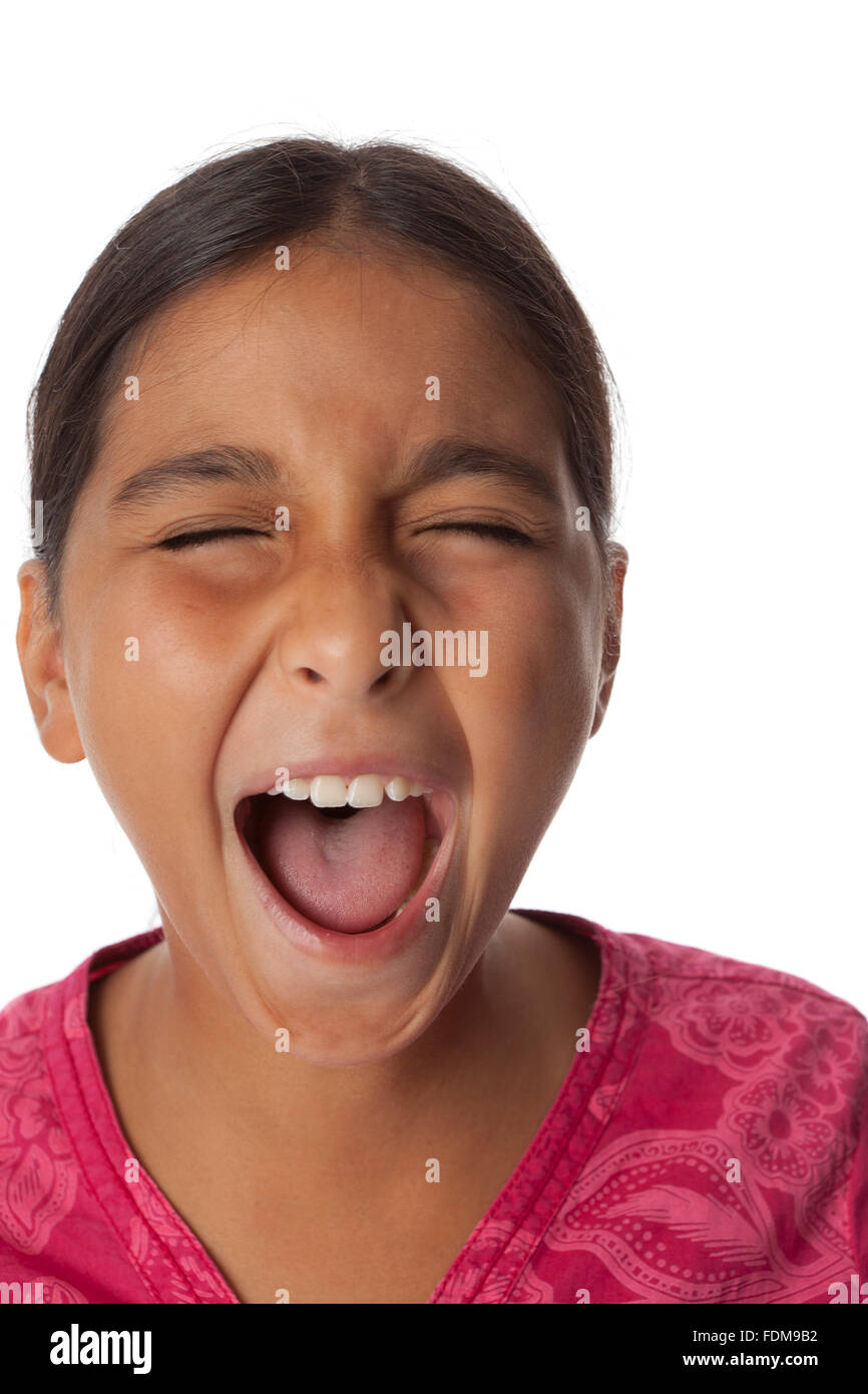 Young teenage girl screaming loud on white background - Stock Image