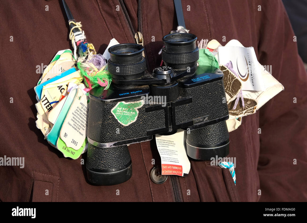 horse racing binoculars with tied course tags - Stock Image