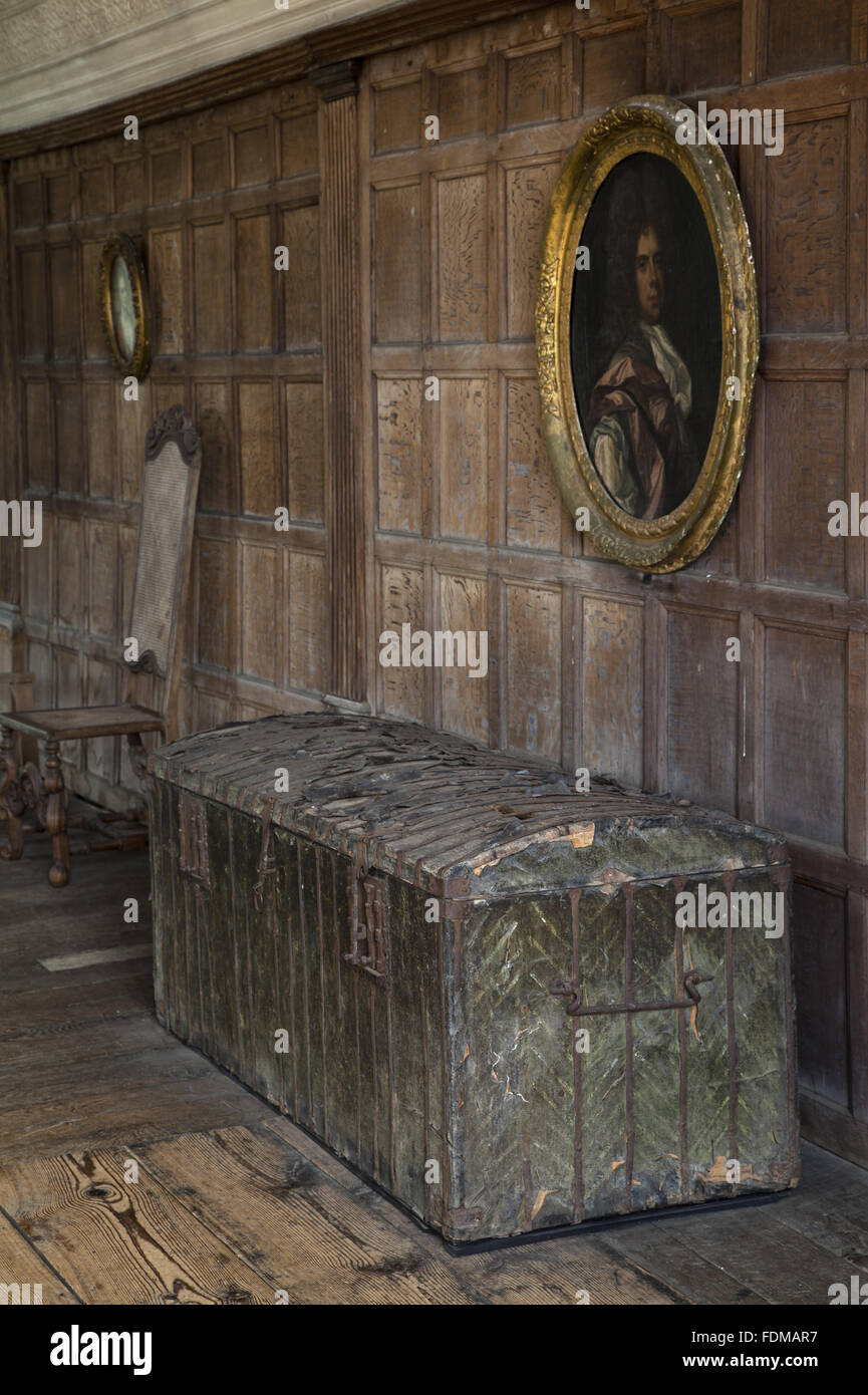 An iron-bound, leather-covered pine chest, c.1500, in the Long Gallery at Chastleton House, Oxfordshire. - Stock Image