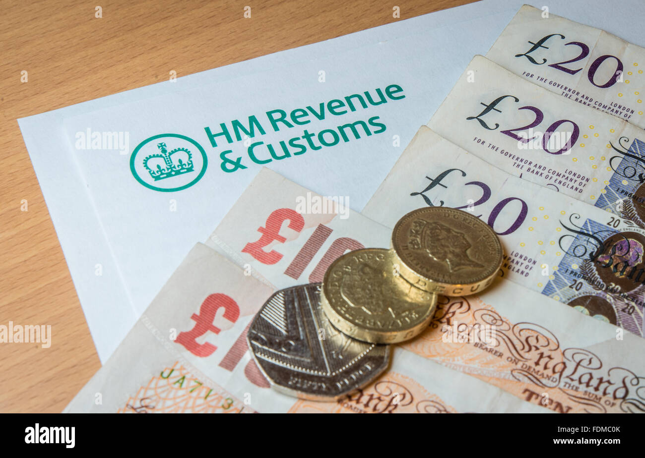 A HMRC letterhead with money - notes and coins. Stock Photo