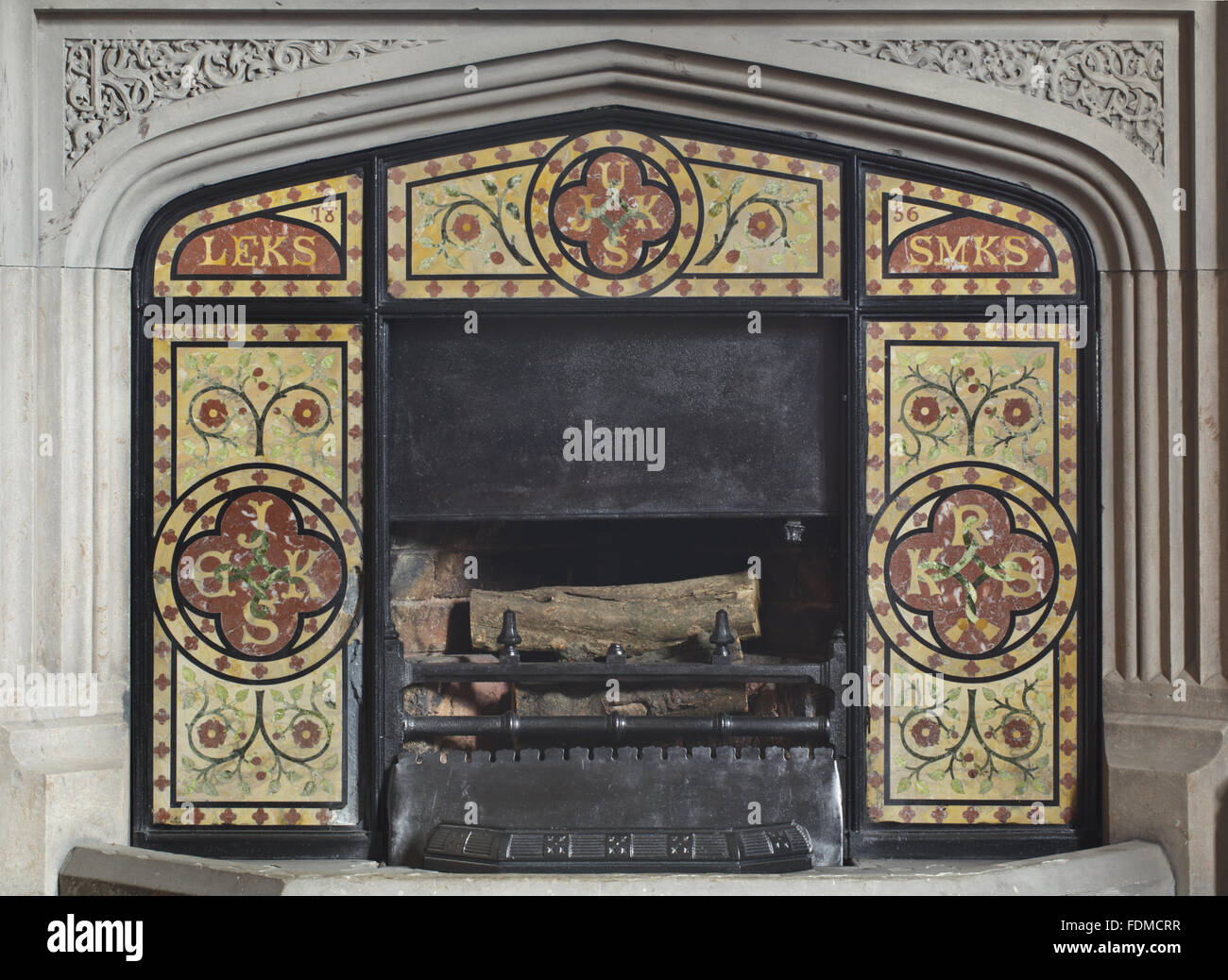1856 Pugin-style fire surround with coloured marble incorporating the initials of Sir James Kay Shuttleworth's - Stock Image