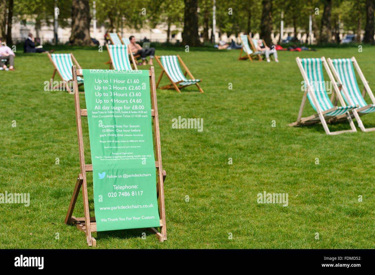 Display of deck chair charges in the London Parks, United Kingdom. - Stock Image