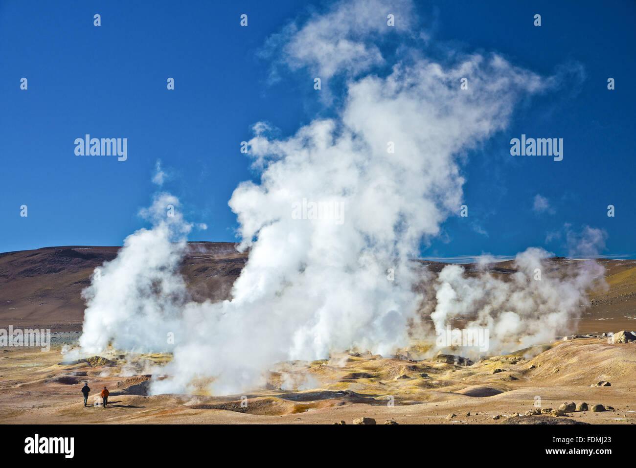 Tourist vapors near the geysers in the Salar de Uyuni - salt desert in the Altiplano - Stock Image