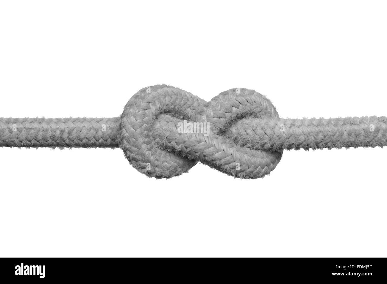 Tight knot on the rope (concept of unsolved problem) isolated on the white background. - Stock Image