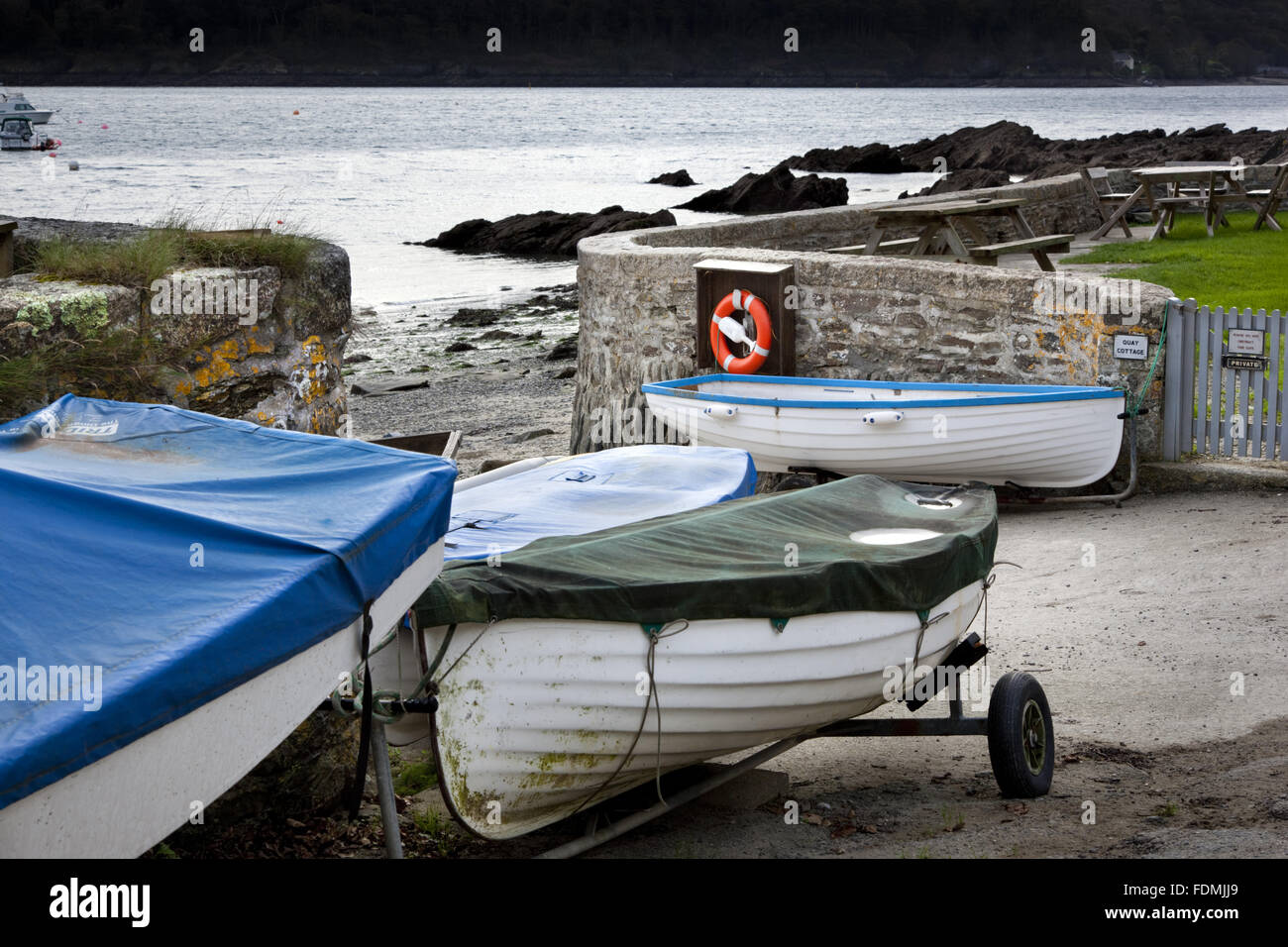 Boats on shore in the hamlet of Durgan, beside the Helford River, South Cornwall. - Stock Image