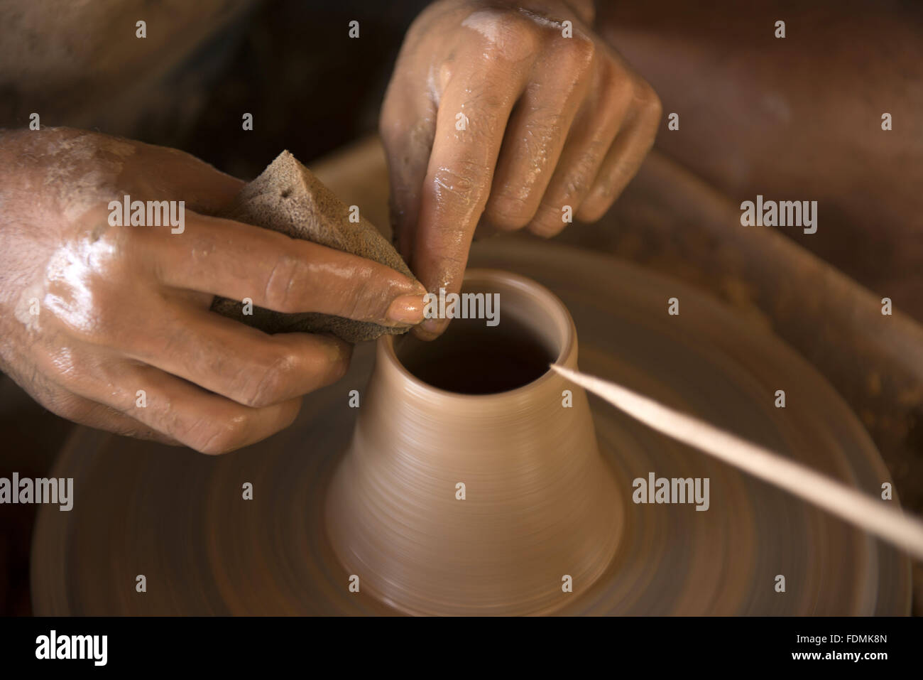 Modeling artisan pottery piece - Sierra Capybara - Stock Image
