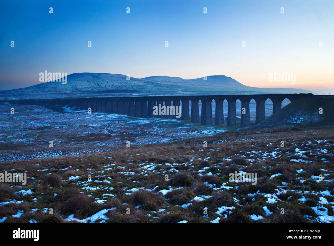 Ribblehead Viaduct and Park Fell Simon Fell and Ingleborough at Dusk Ribblehead Yorkshire Dales England - Stock Image