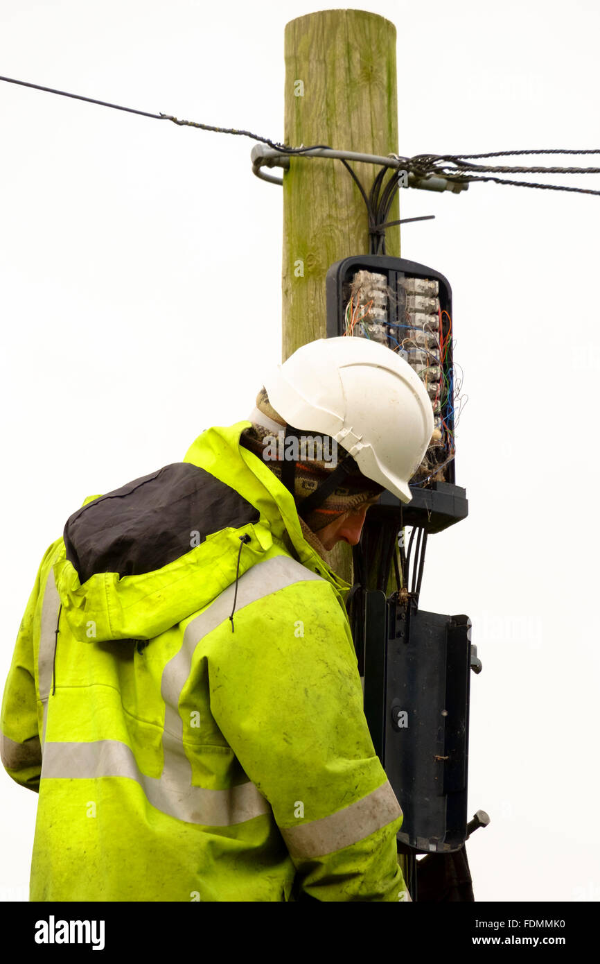British Telecom engineer replacing a telegraph pole in Salisbury on a cold wintry day Stock Photo