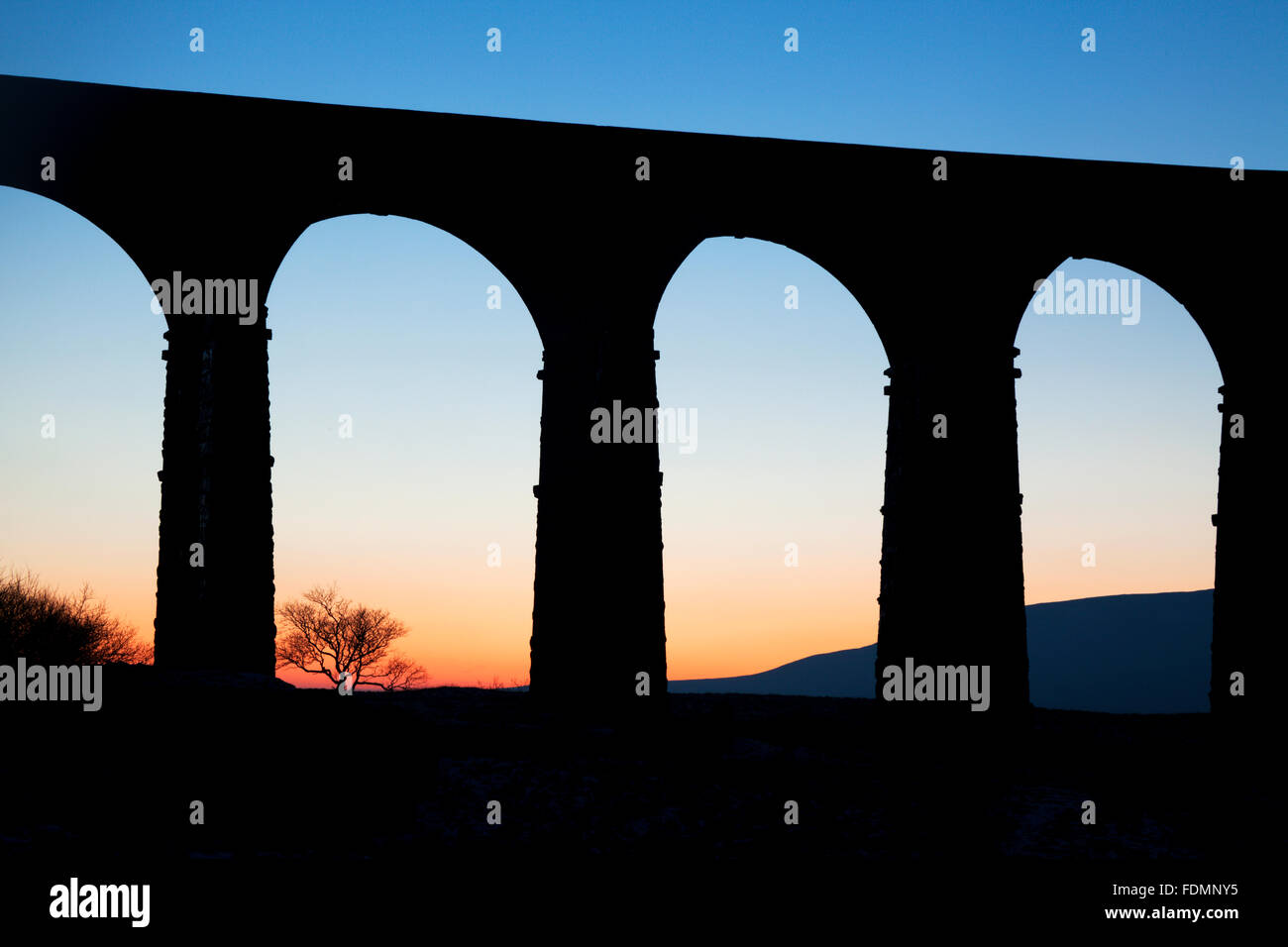 Arches of the Ribblehead Viaduct at Dusk Ribblehead Yorkshire Dales England Stock Photo