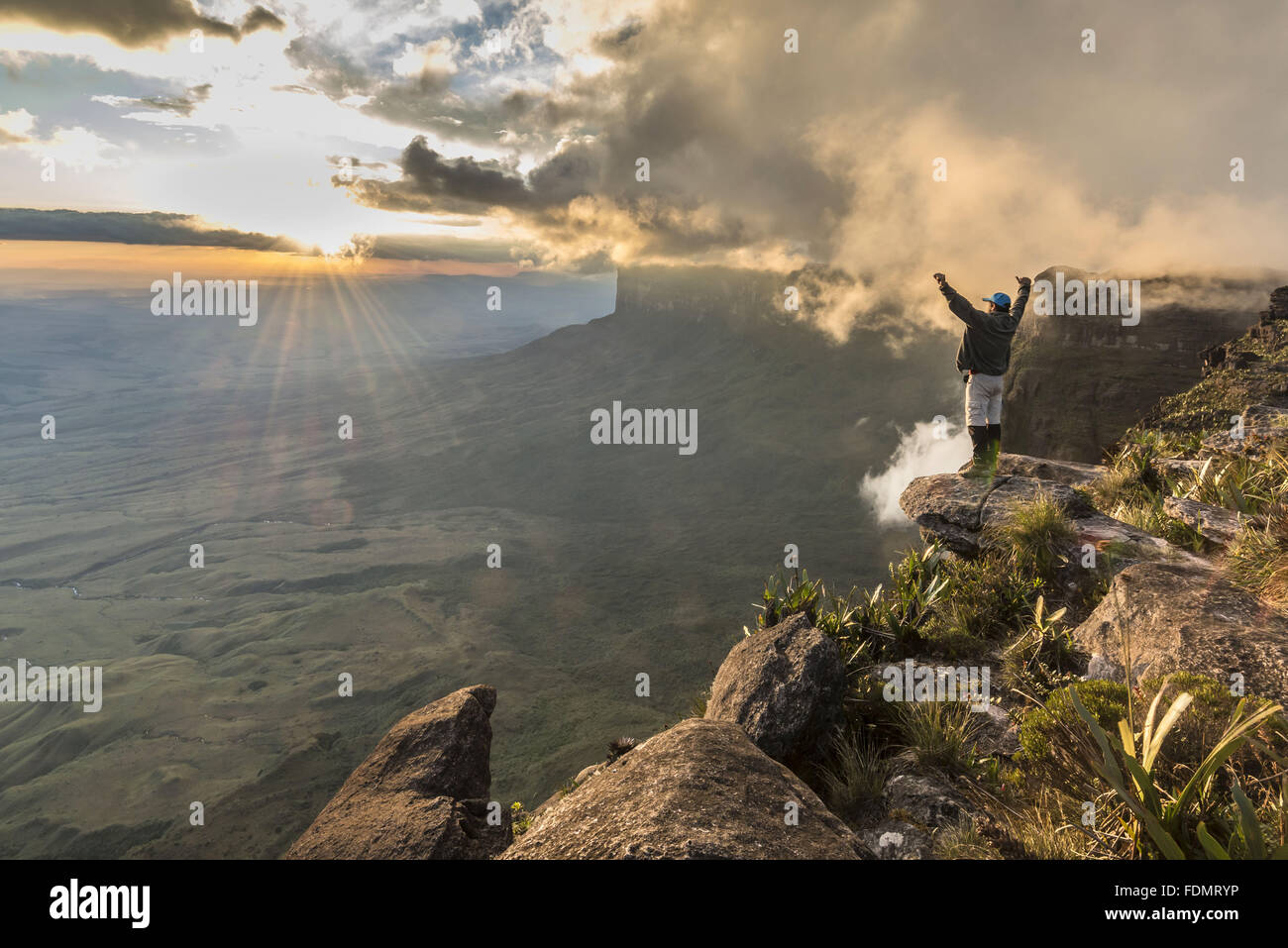 Tourist contemplating for sunsets in the Mount Roraima National Park - Sierra de Pacaraima - Stock Image