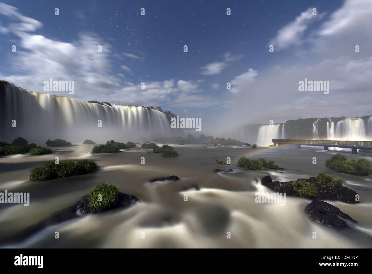 Night rainbow formed by the light of the full moon in the Iguaçu Falls - Stock Image