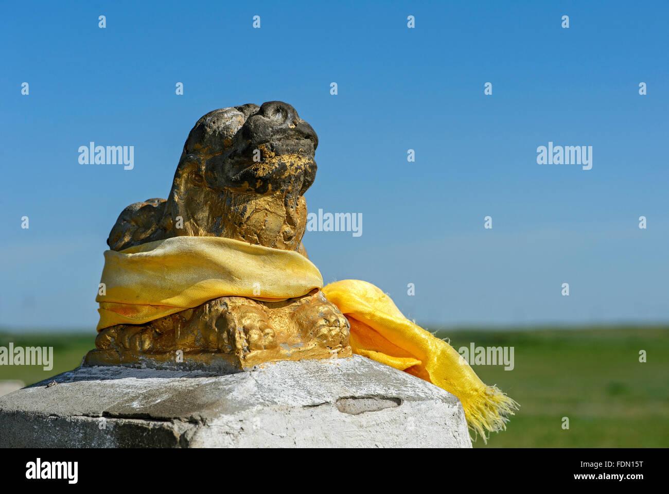 Sculpture of lion with yellow prayer shawl, Khata, Erdene Zuu Monastery, Kharkhorin, UNESCO World Heritage Site, - Stock Image