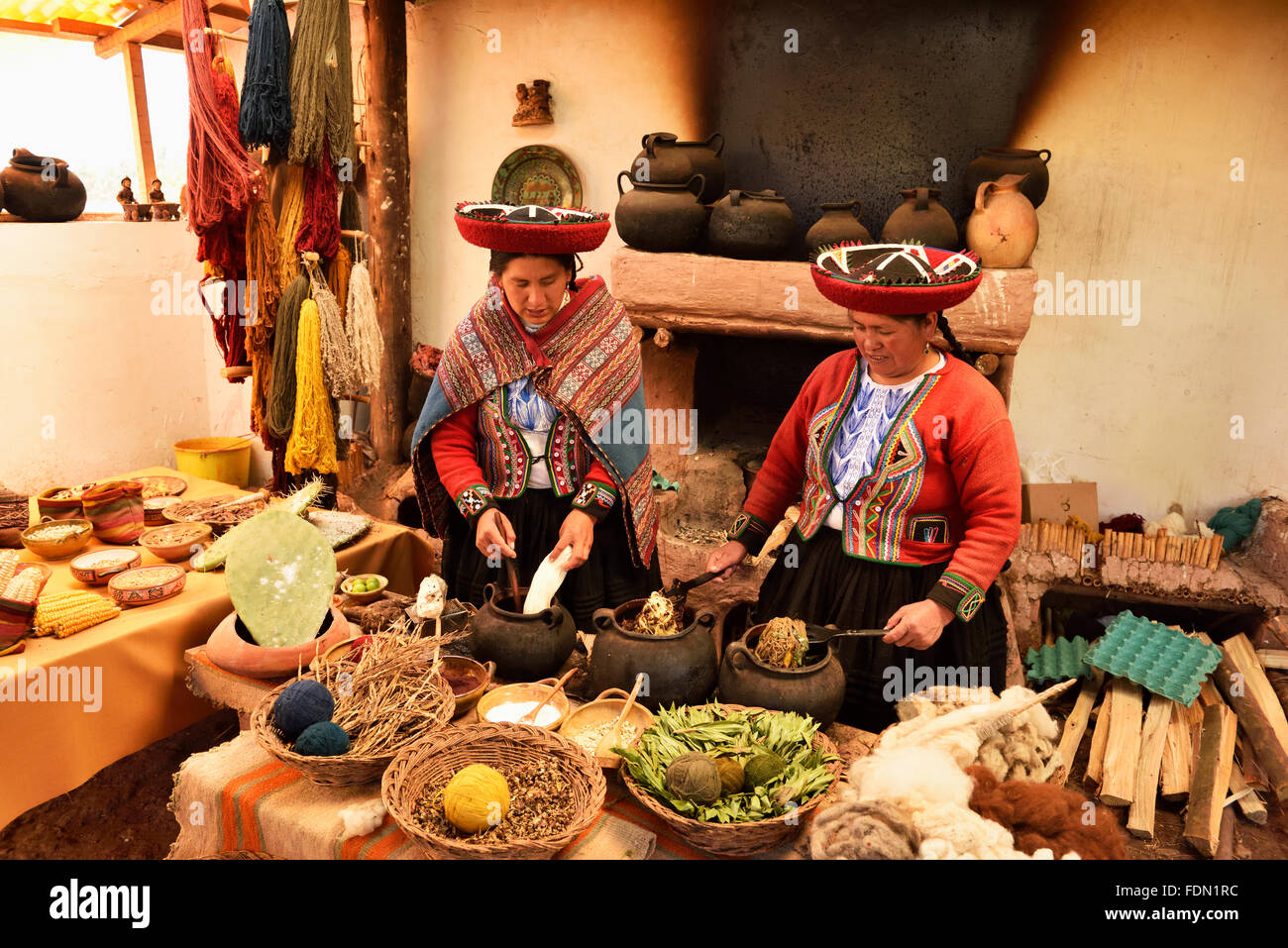 Two Peruvians, traditional alpaca wool dyeing, Chinchero, Cusco Province, Peru Stock Photo