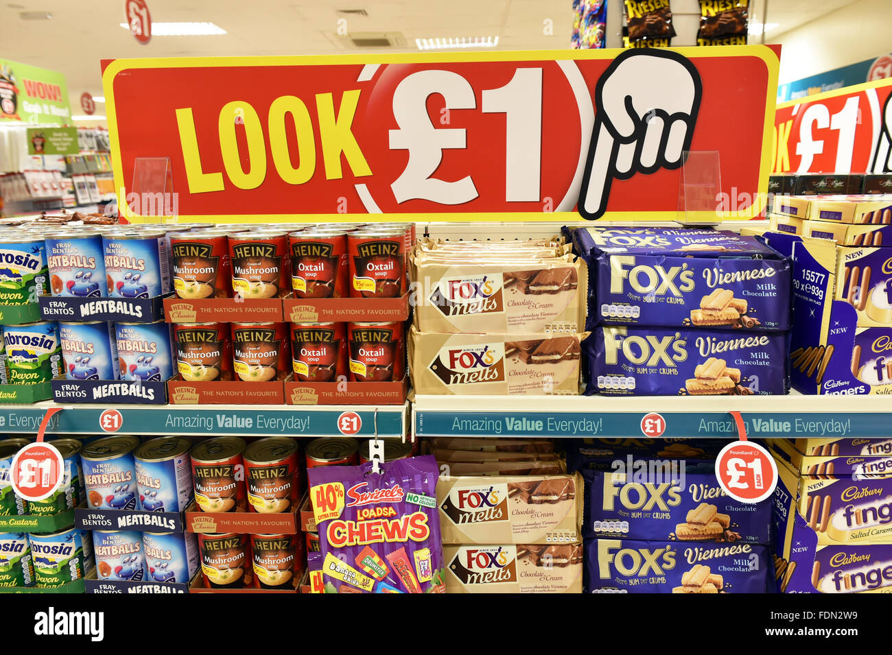 Tins of soup and biscuits on a shop shelf all for a pound UK - Stock Image