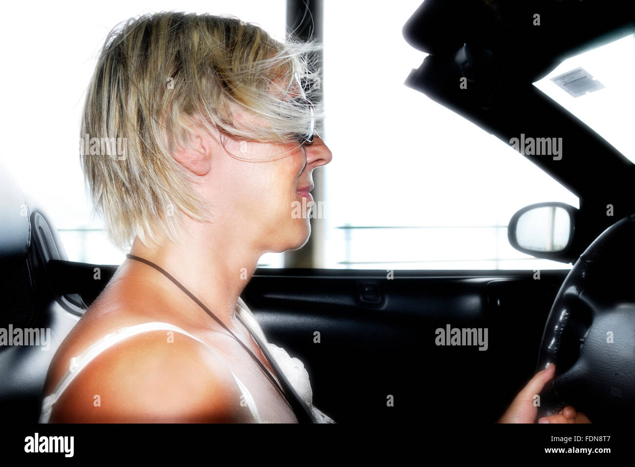 motion,speed,airflow,cabriolet,car driver - Stock Image
