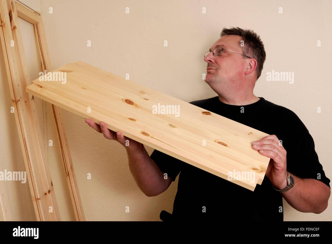domestic life,shelf construction,montage - Stock Image