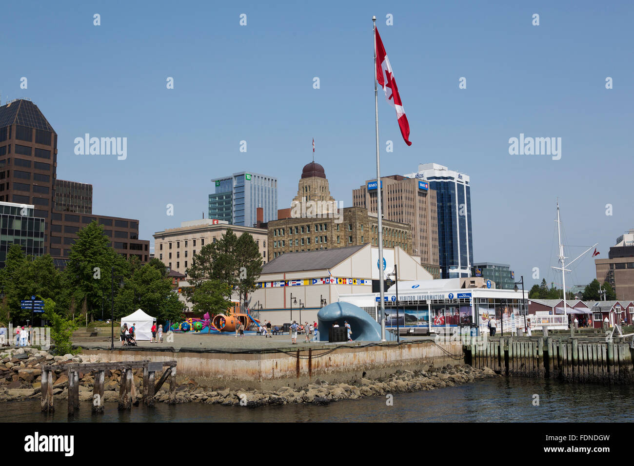 A Canadian flag on a flagpole by the waterfront in Halifax, Canada. - Stock Image