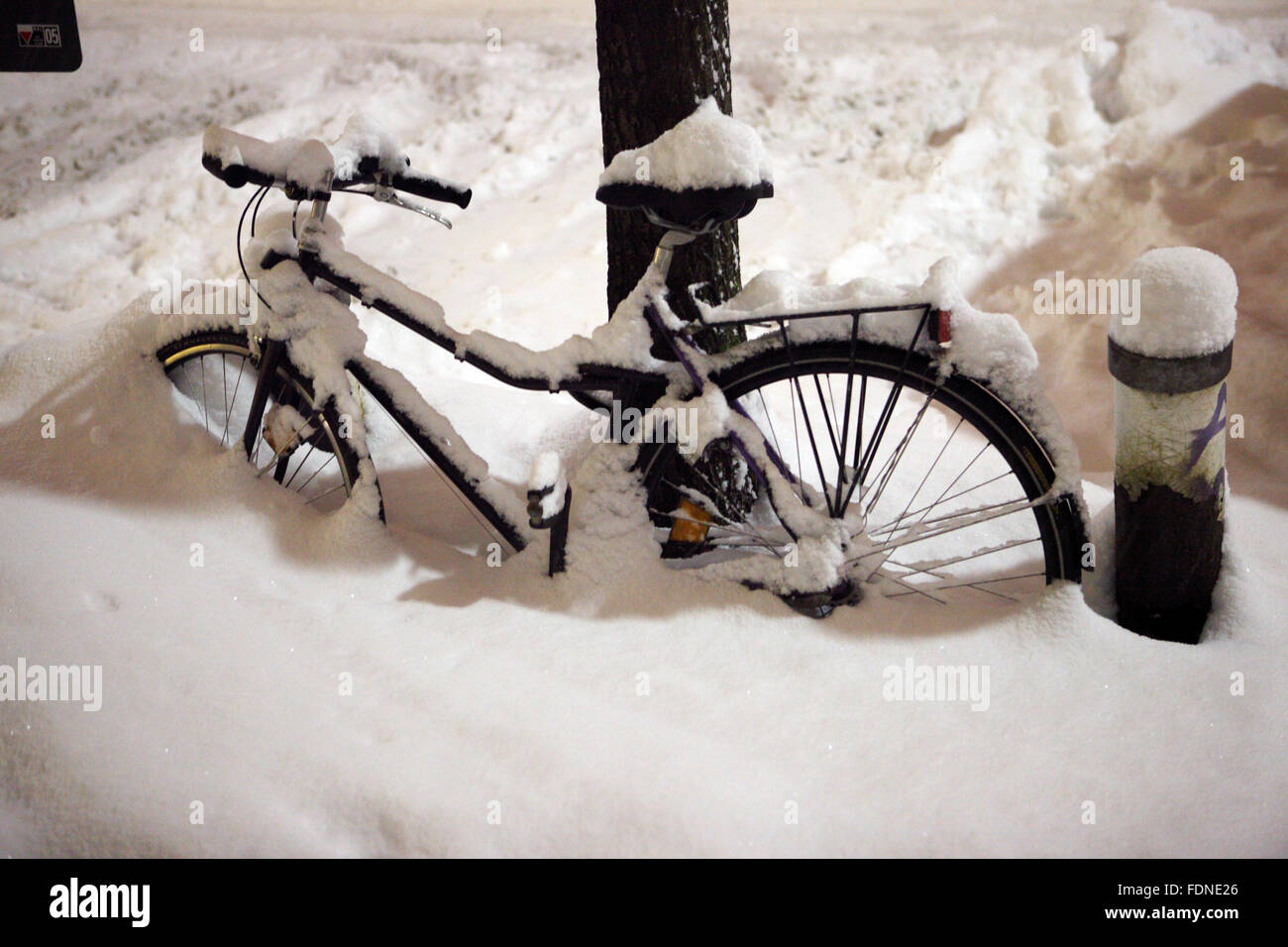 Berlin, Germany, Bicycle is snowed in - Stock Image