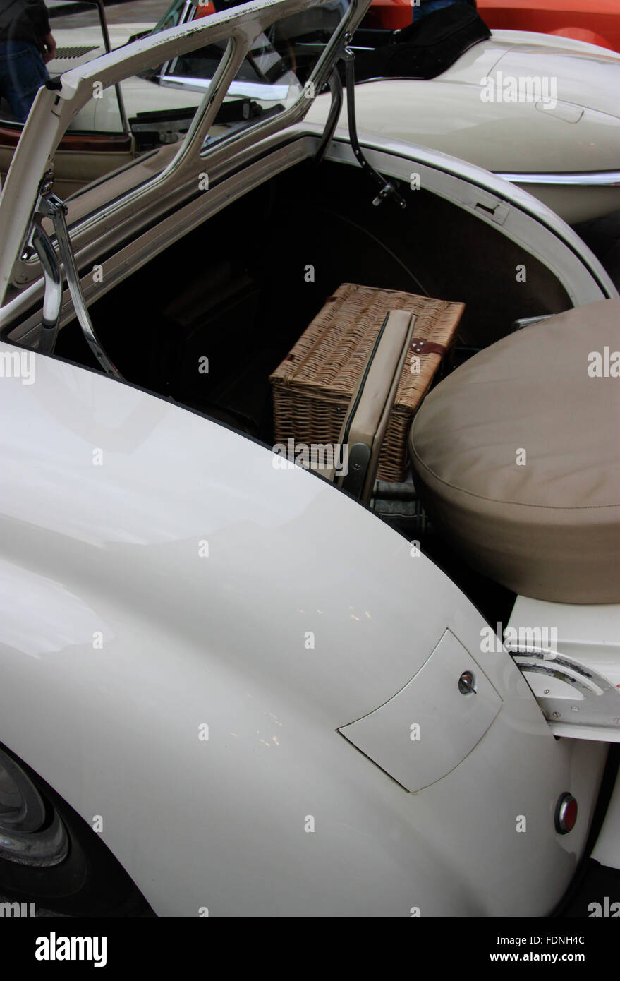 Dicky/dickie seat for child in back of 1930s classic car folding windscreen picnic hamper - Stock Image