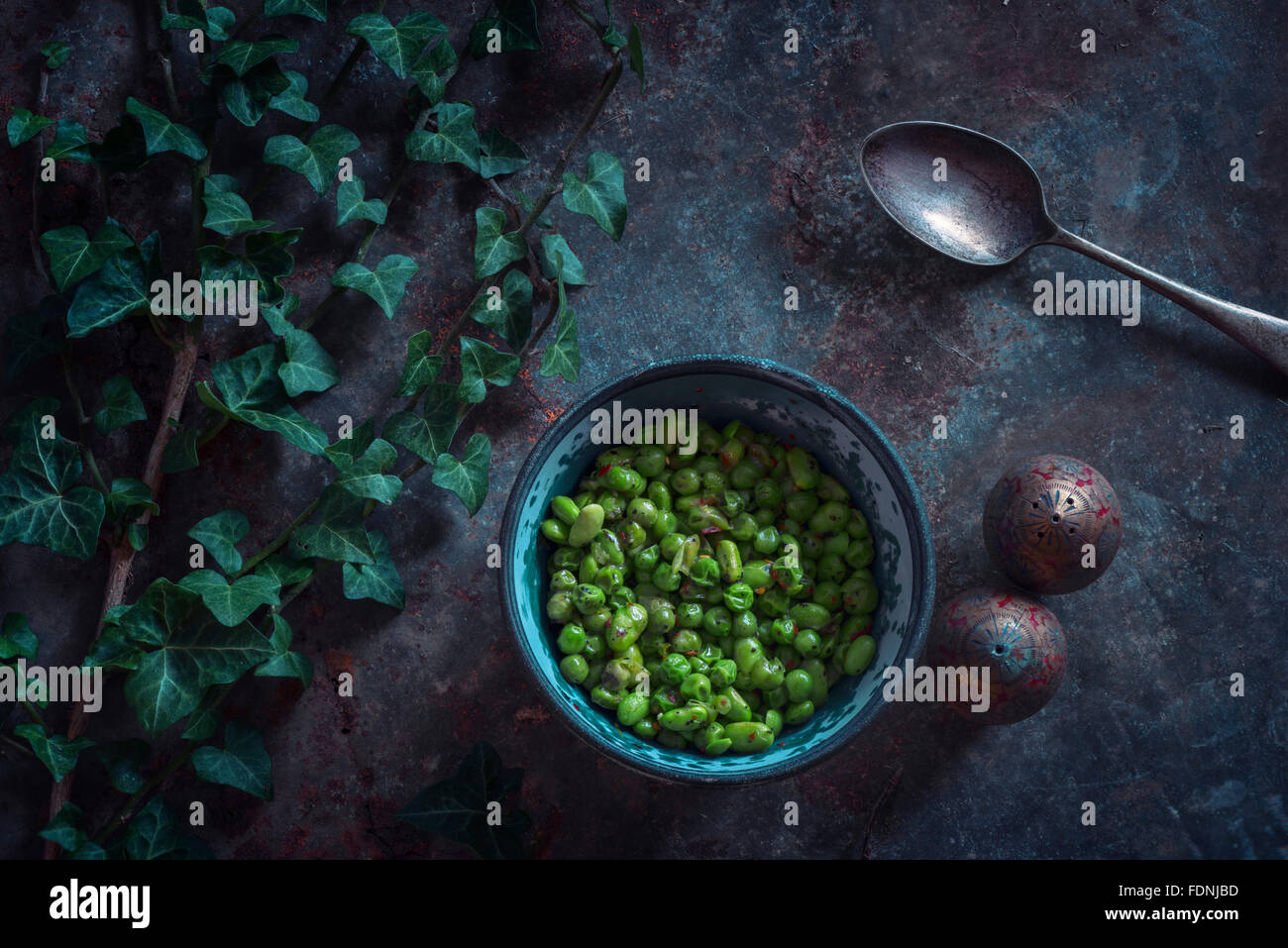 A bowl of Edamame beans and peas. - Stock Image