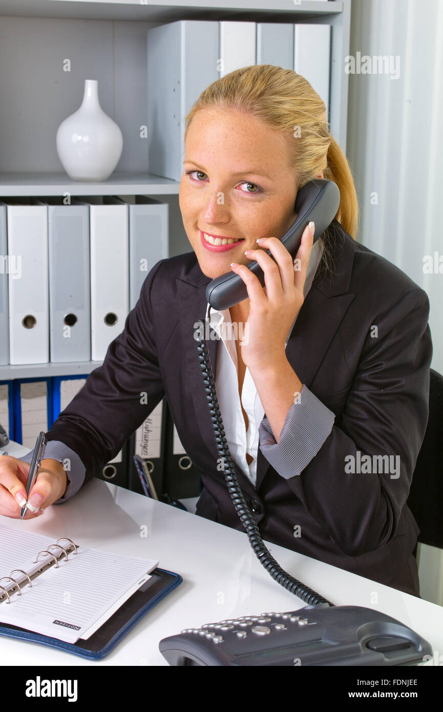 office assistant,telephone conversation,customer service - Stock Image