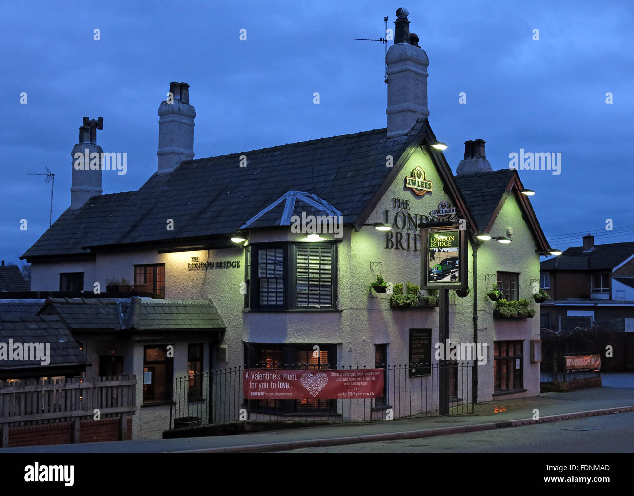 The London Bridge Pub,Stockton Heath,Warrington, At Night,Cheshire,England,UK - Stock Image