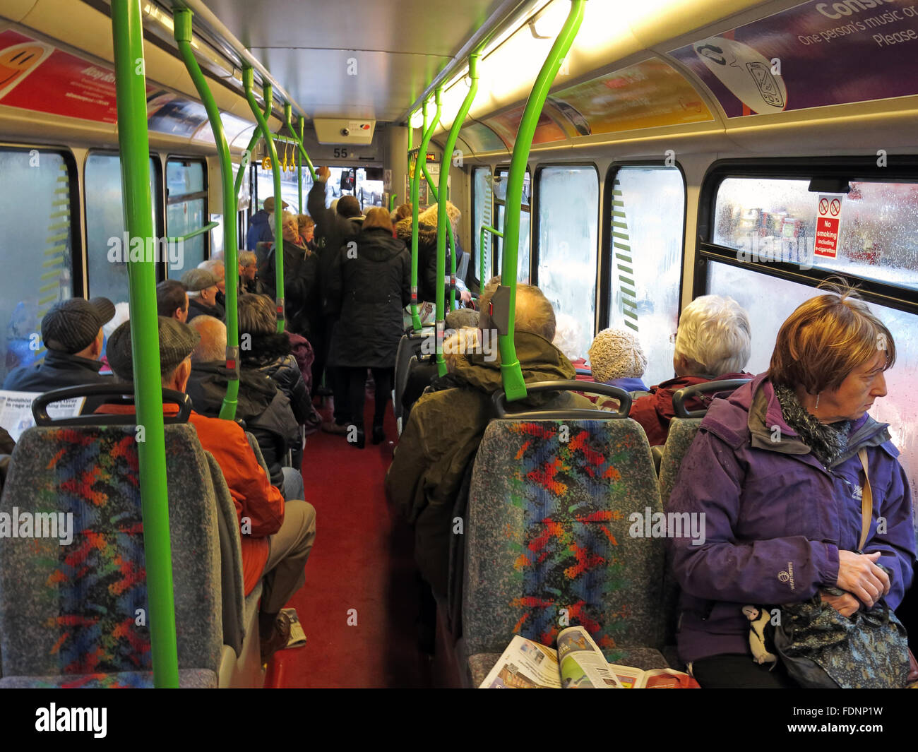 A busy public bus in Warrington,Cheshire,England,UK with passengers - Stock Image