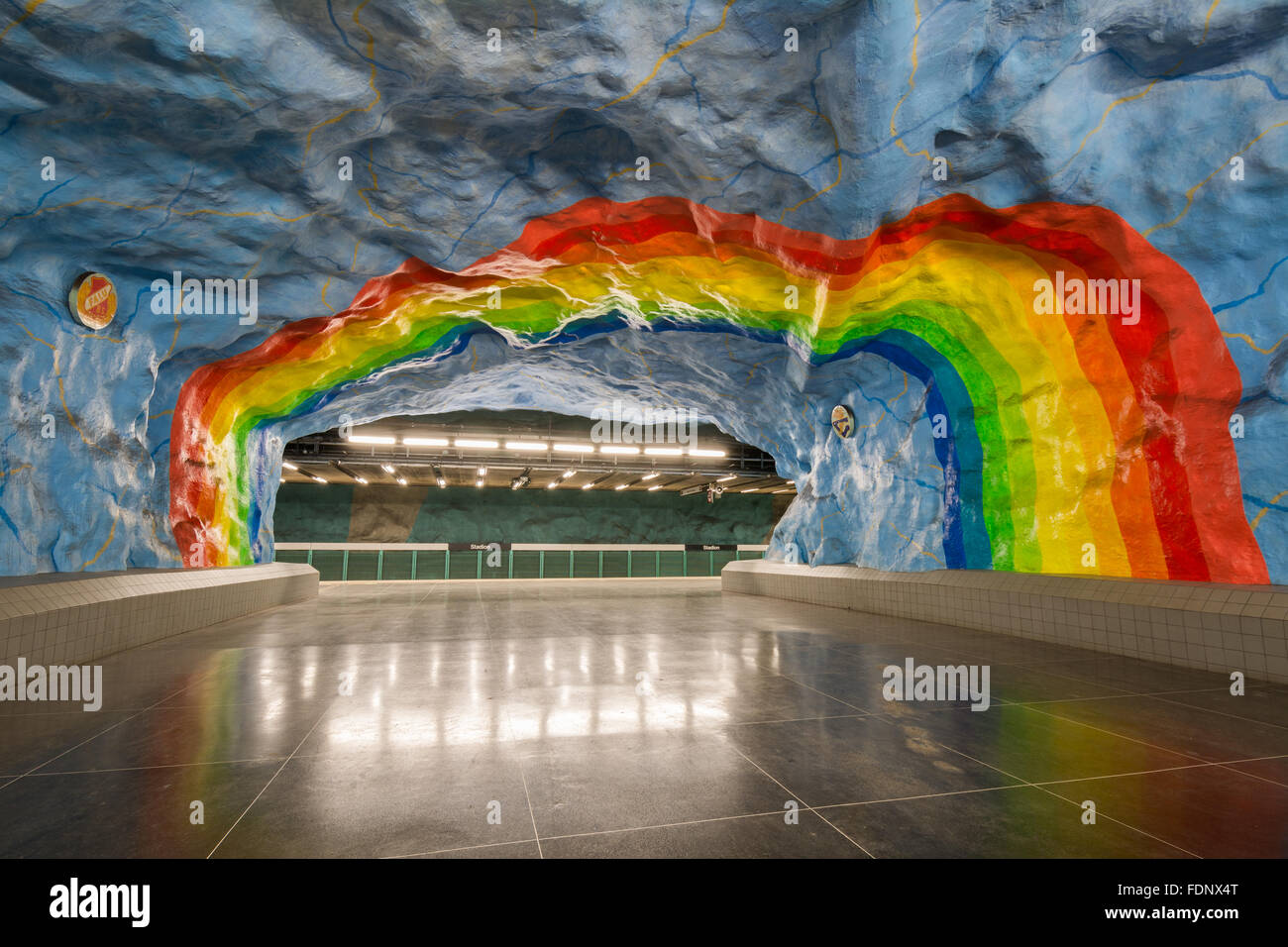 Giant colourful rainbow painted on the walls of Stadion Underground Station in Stockholm. - Stock Image