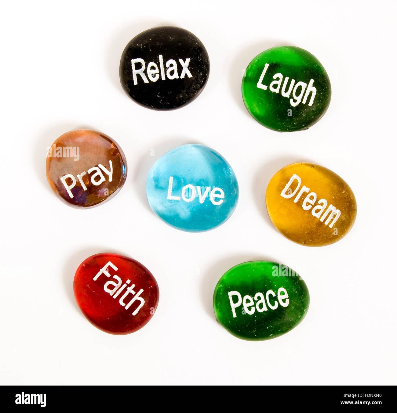 Seven Encouragement Stones on White - Stock Image